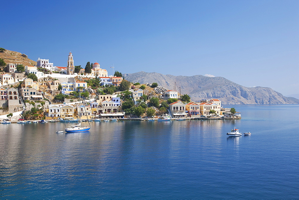 View across the tranquil waters of Harani Bay, Gialos (Yialos), Symi (Simi), Rhodes, Dodecanese Islands, South Aegean, Greece, Europe