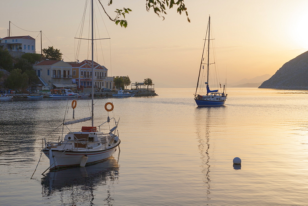 View across the tranquil harbour, sunrise, Gialos (Yialos), Symi (Simi), Rhodes, Dodecanese Islands, South Aegean, Greece, Europe - 390-2926