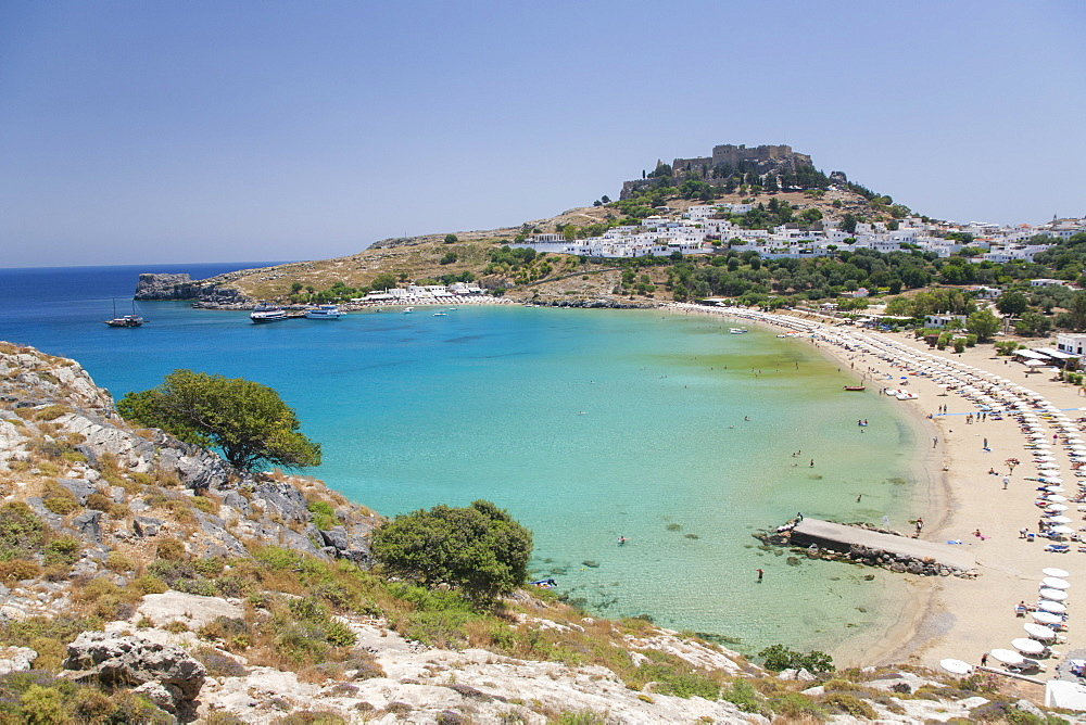 View over the clear turquoise waters of Lindos Bay, Lindos, Rhodes, Dodecanese Islands, South Aegean, Greece, Europe