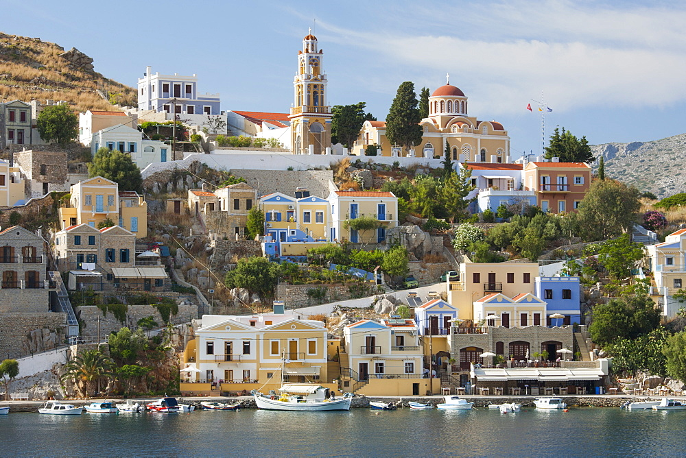 View over harbour to colourful houses and church, Gialos (Yialos), Symi (Simi), Rhodes, Dodecanese Islands, South Aegean, Greece, Europe - 390-2934