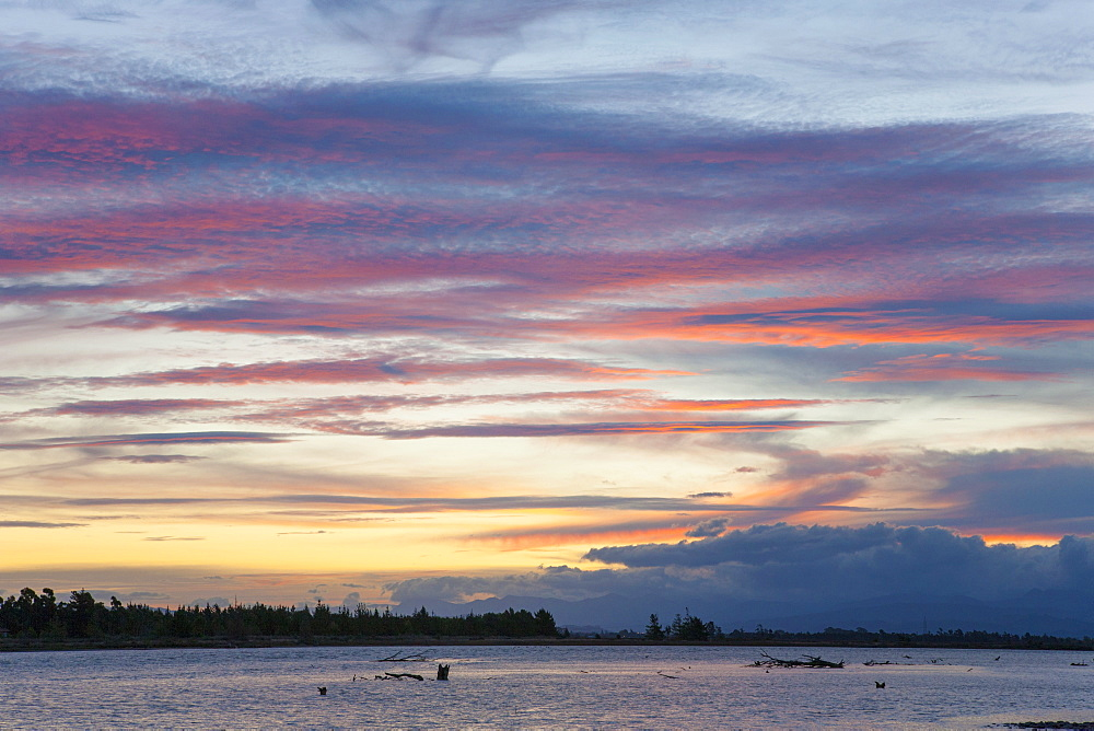 Pink clouds over the Wairau River estuary at dusk, Wairau Bar, near Blenheim, Marlborough, South Island, New Zealand, Pacific