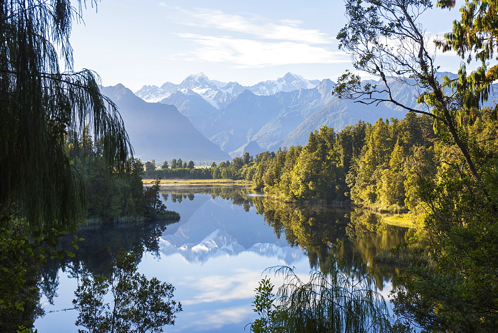 Mount Tasman and Aoraki (Mount Cook) reflected in Lake Matheson, Westland Tai Poutini National Park, UNESCO World Heritage Site, West Coast, South Island, New Zealand, Pacific - 390-2952