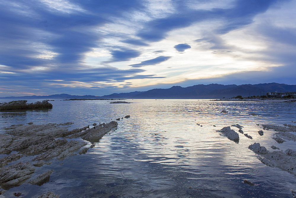 View across the tranquil waters of South Bay at dusk, Kaikoura, Canterbury, South Island, New Zealand, Pacific - 390-2965