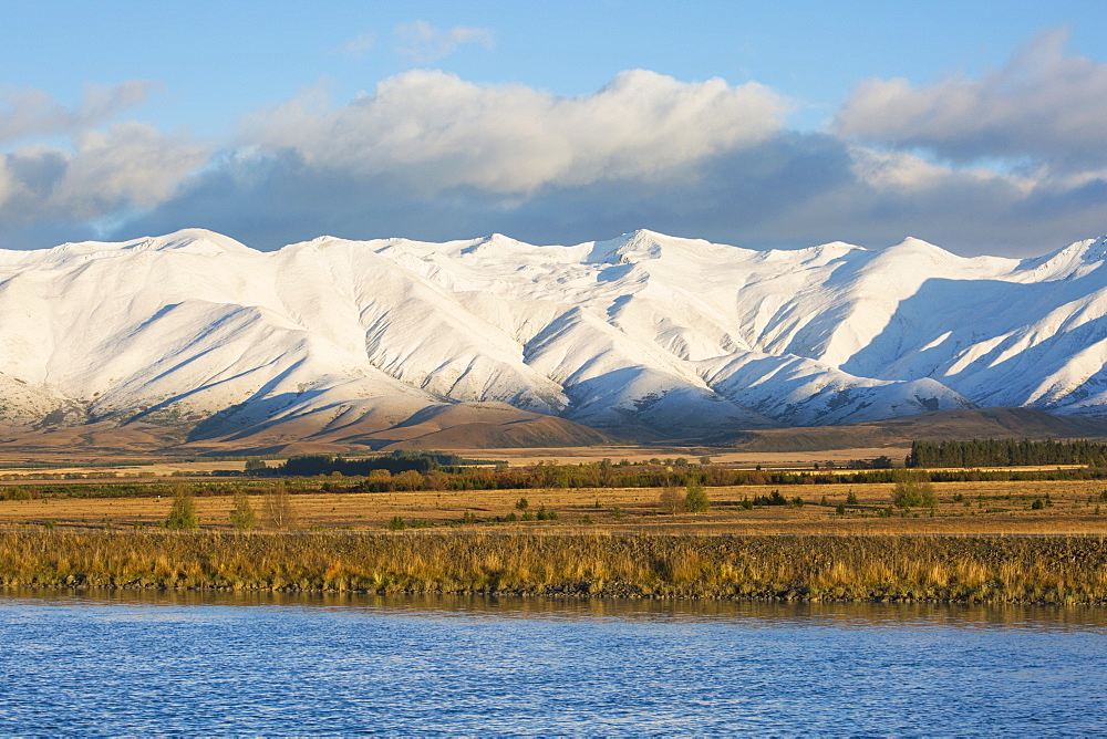 The Ben Ohau Range cloaked in autumn snow, the Pukaki Canal in foreground, Twizel, Mackenzie district, Canterbury, South Island, New Zealand, Pacific - 390-2979