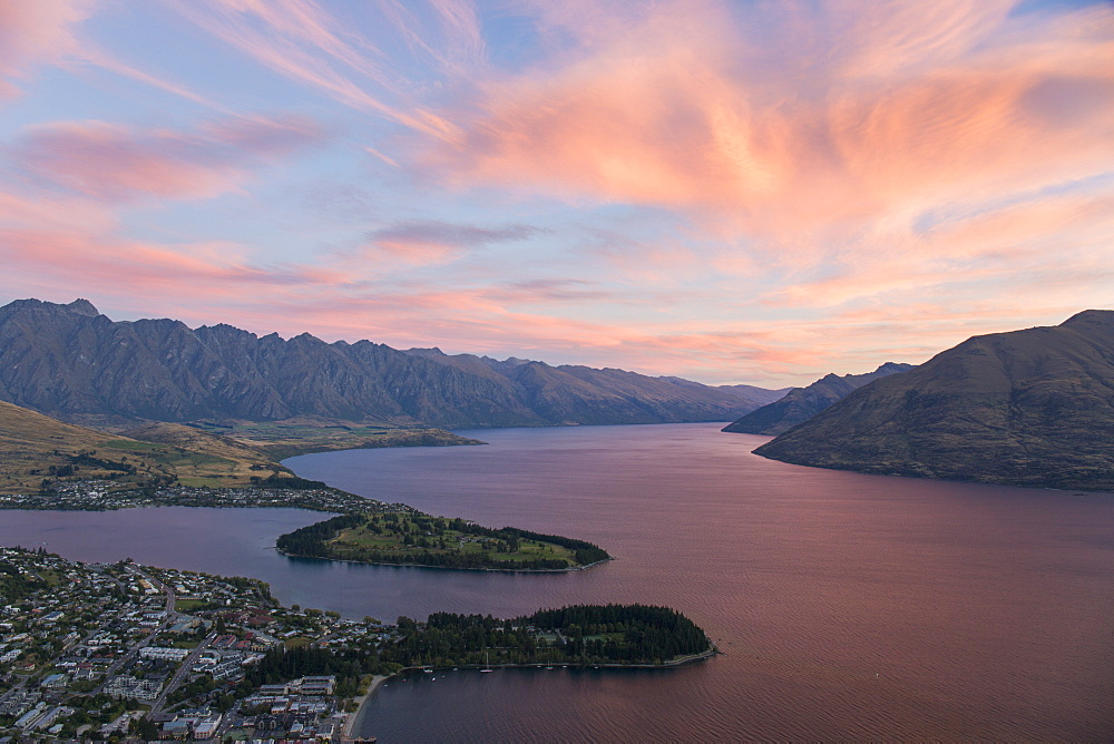 Pink clouds over Lake Wakatipu and the Remarkables, dusk, Queenstown, Queenstown-Lakes district, Otago, South Island, New Zealand, Pacific