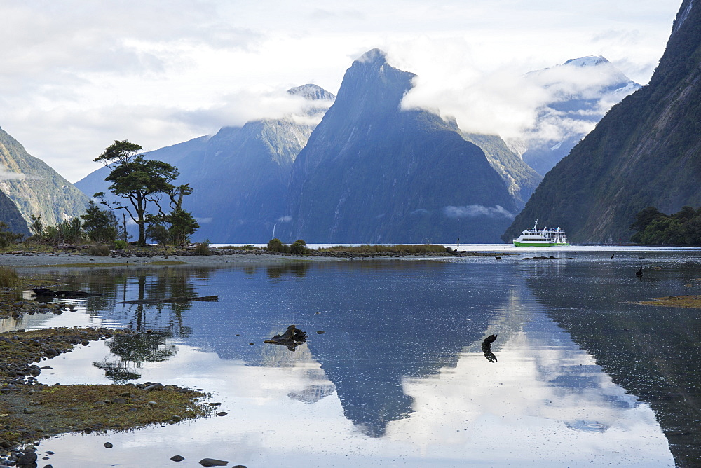 View down Milford Sound, mountains reflected in water, Milford Sound, Fiordland National Park, UNESCO World Heritage Site, Southland, South Island, New Zealand, Pacific