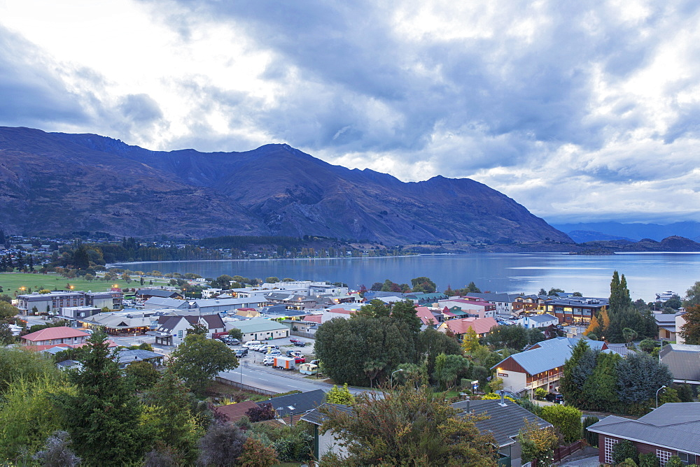 View over rooftops to Lake Wanaka at dusk, Wanaka, Queenstown-Lakes district, Otago, South Island, New Zealand, Pacific