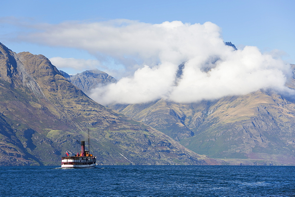 The steamship TSS Earnslaw on Lake Wakatipu, clouds over Walter Peak, Queenstown, Queenstown-Lakes district, Otago, South Island, New Zealand, Pacific