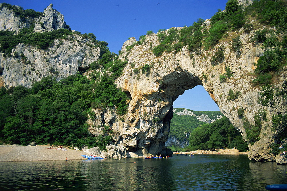 The Pont d'Arc, a natural rock arch over the Ardeche River, in the Ardeche Gorges, in the Ardeche region of the Rhone Alpes, France, Europe