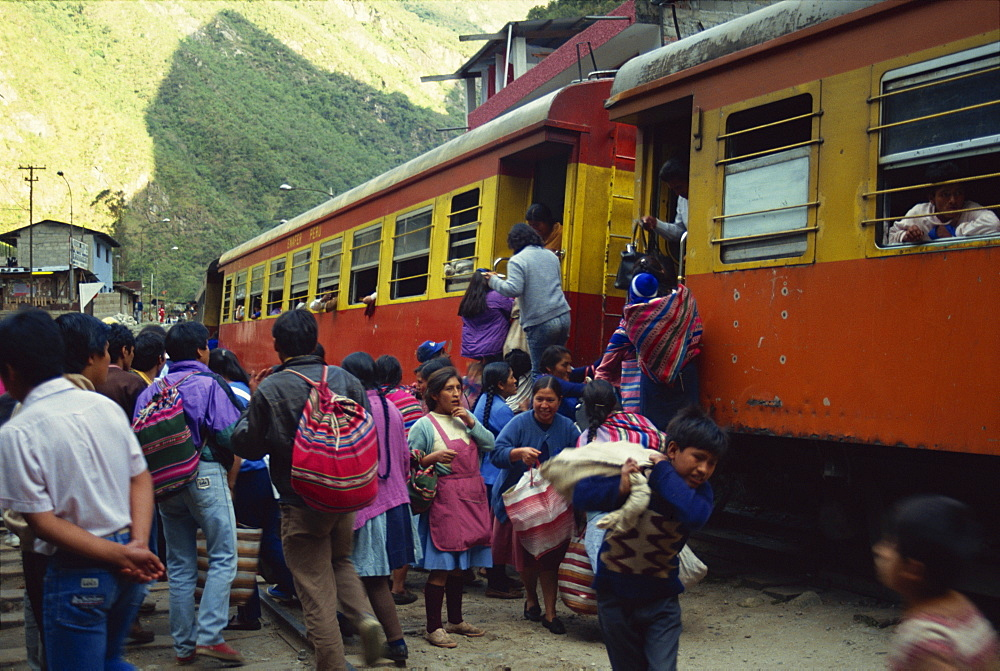 Passengers leaving and boarding the train at the railway station at Aguas Calientes below Machu Picchu in Peru, South America