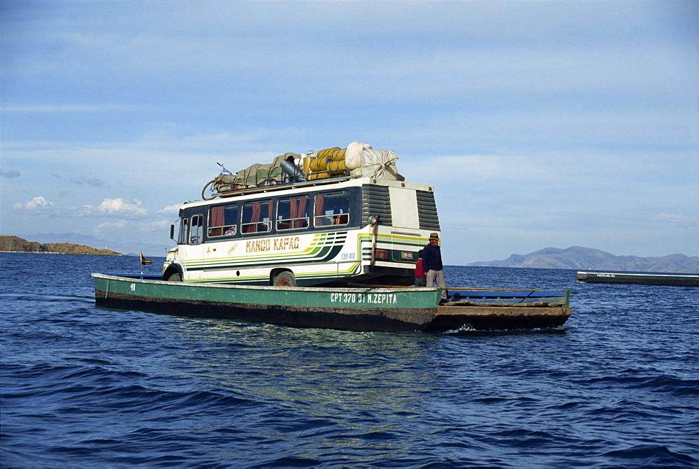 Minibus crossing Lake Titicaca on a ferry in Bolivia, South America