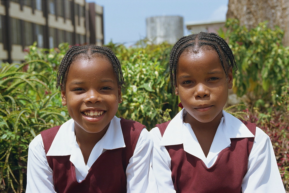Portrait of two schoolgirls in school uniform, St. John, Barbados, West Indies, Caribbean, Central America