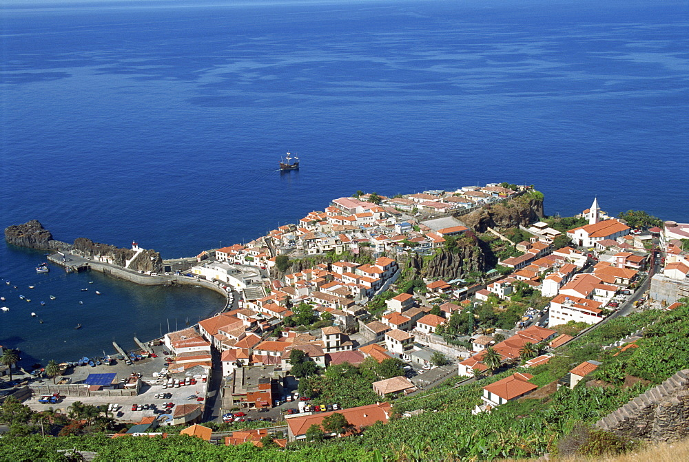 Low aerial view of the coast and the town of Camara de Lobos on the island of Madeira, Portugal, Atlantic, Europe