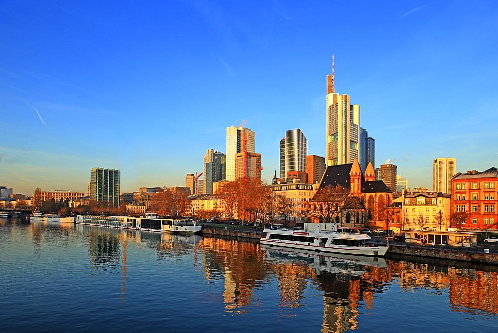 View across Main River towards the skyline of Frankfurt am Main, Hesse, Germany, Europe