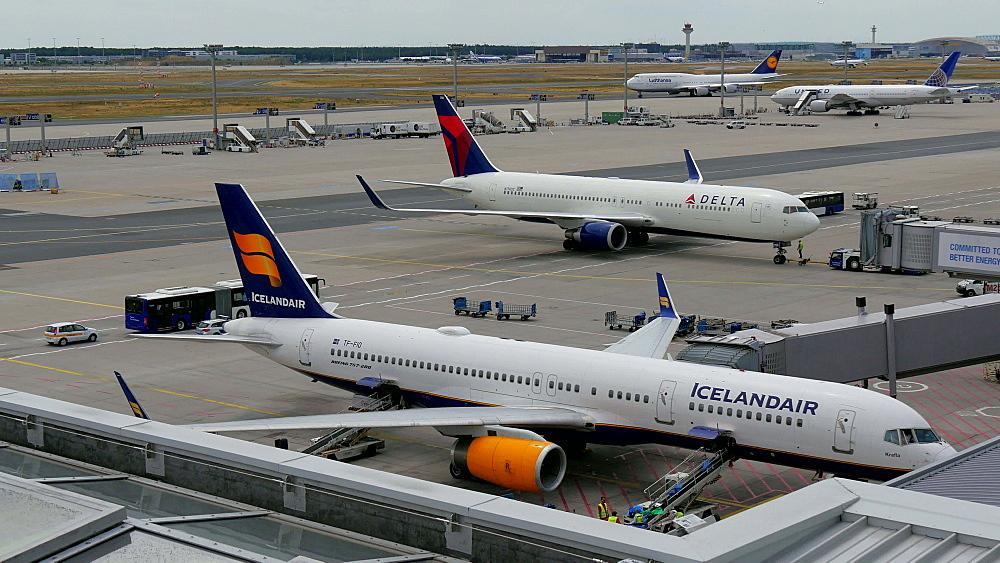 Icelandair and Delta jets at Terminal 2, Frankfurt Airport, Frankfurt am Main, Hesse, Germany