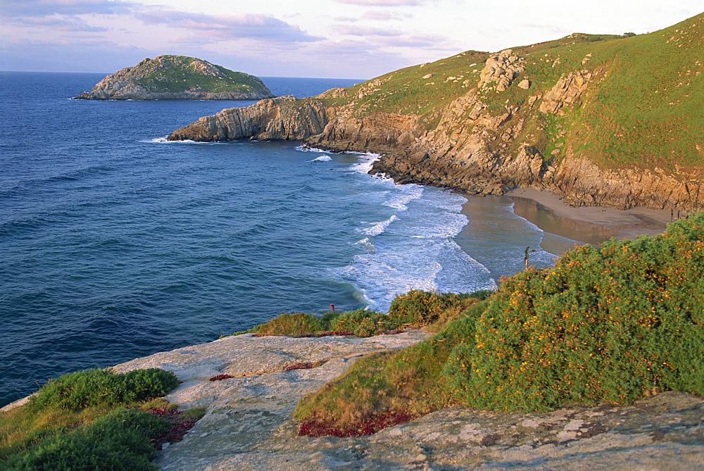 Rocky coastline and inaccessible beach near Punt de Moras on the north coast, Rias Altas in Galicia, Spain, Europe