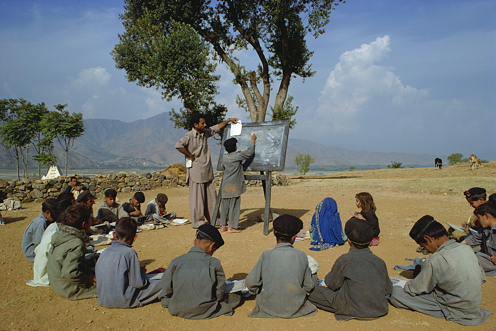 Two school girls separated from the boys at a village school in the Swat valley, Pakistan, Asia