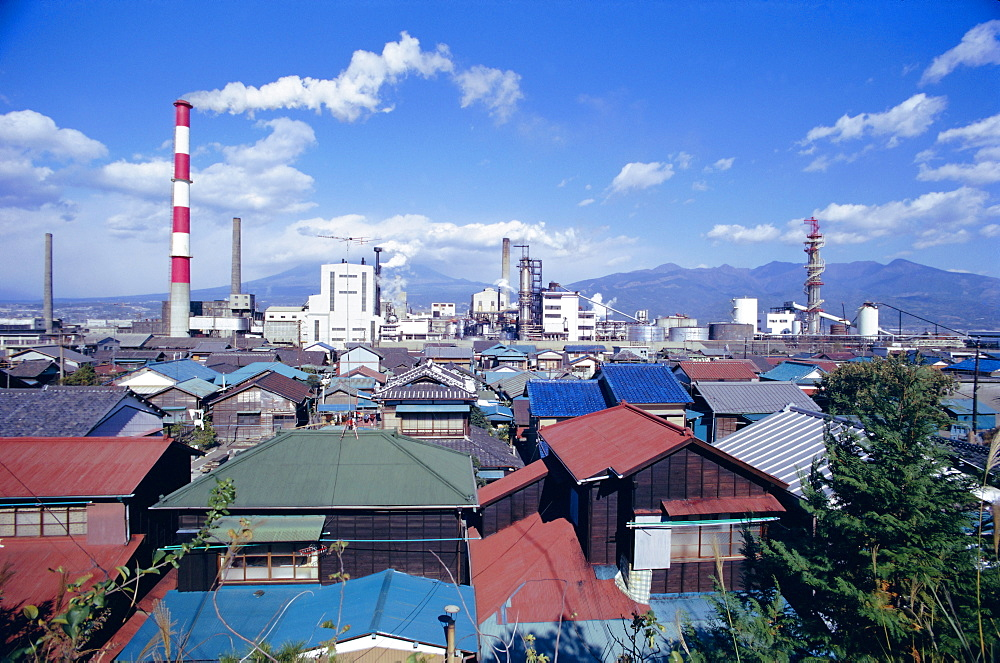 Industrial complex of paper mill and city skyline, Yoshiwara, Japan, Asia