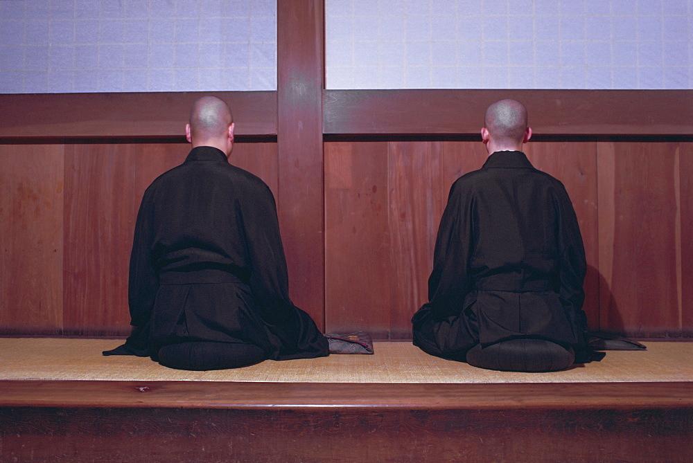 Two monks during Za-Zen meditation in the Sodo or Zazendo hall, Elheiji (Eiheiji) Zen monastery, Japan, Asia - 399-3658