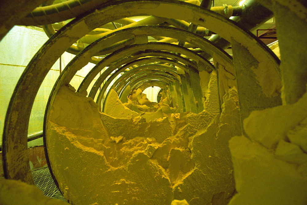Yellow cake, powdery uranium oxide in Burwell filter press, Uranium City, Saskatchewan, Canada, North America - 399-4227