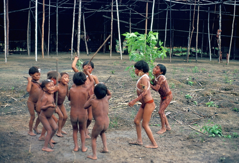 Yanomami children playing inside the yano, Toototobi, Roraima, Brazil, South America