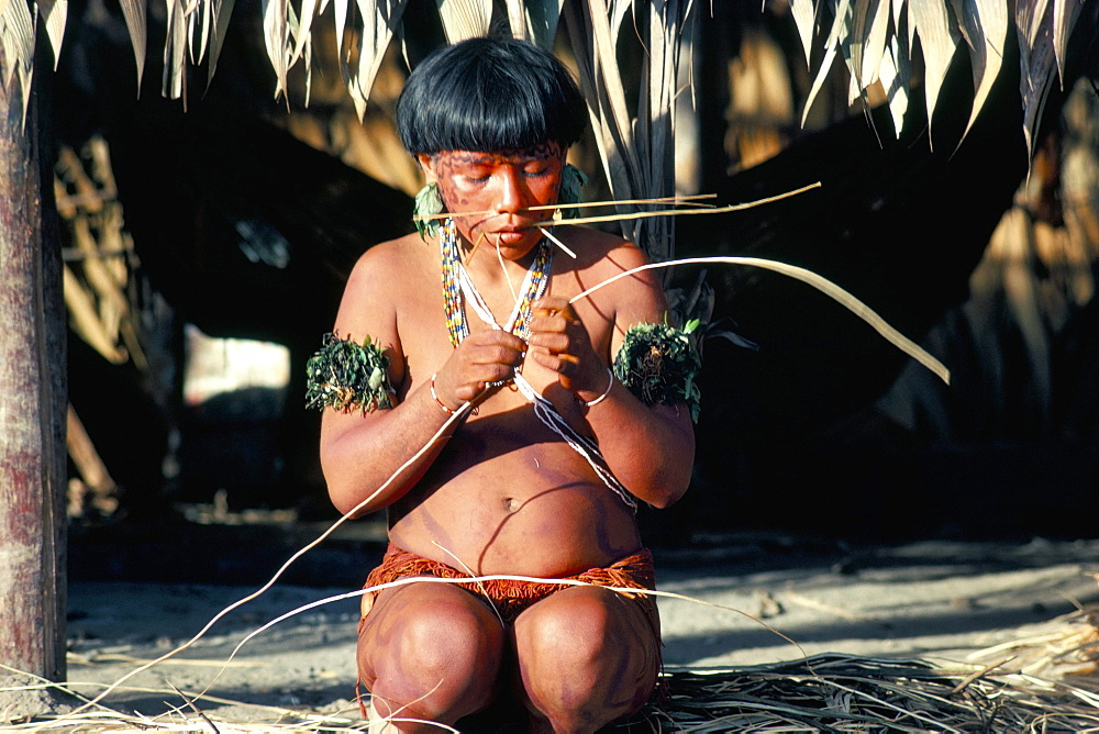 Yanomami with vine for basket making, Brazil, South America