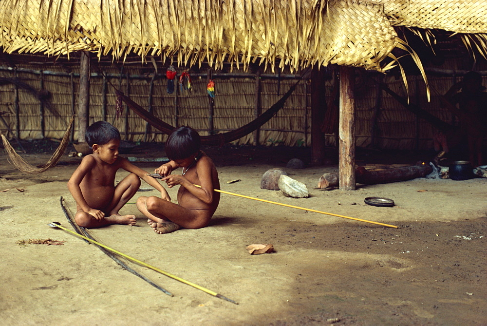 Yanomami Indian children making arrows, Brazil, South America