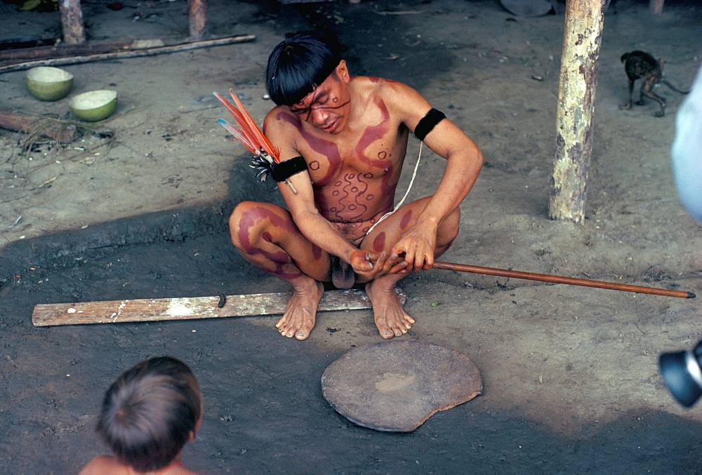 Yanomami man preparing hallucinogenic snuff, Brazil, South America