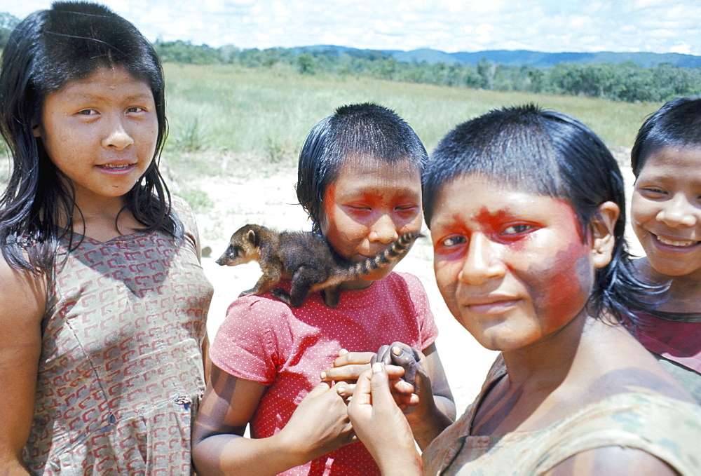 Gorotire Indian girls with coati, Brazil, South America