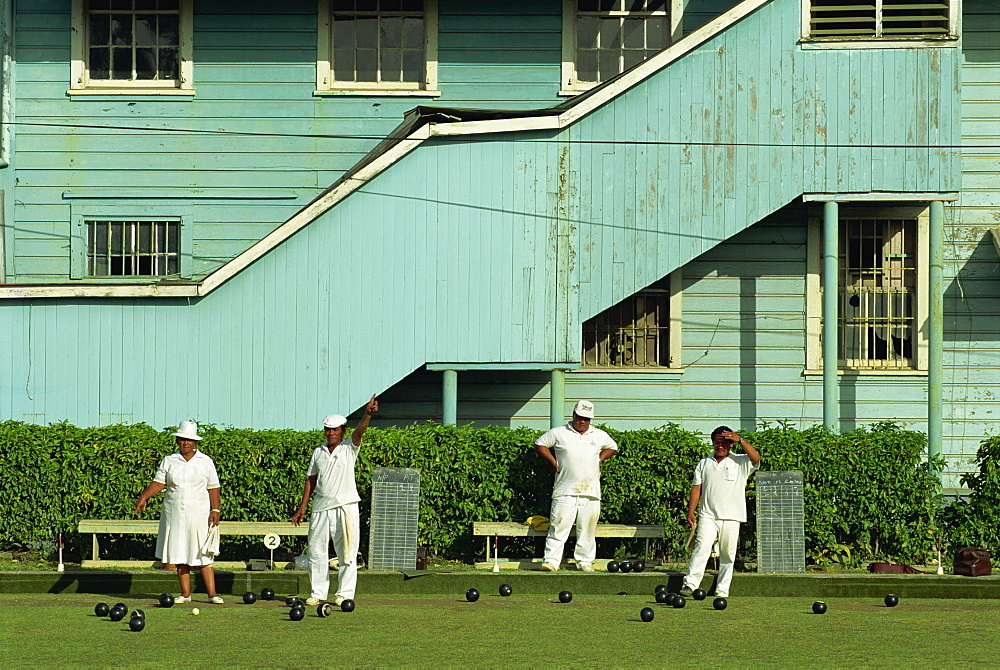 Men and women on a bowling green in Apia on the island of Upolu in Western Samoa, Pacific