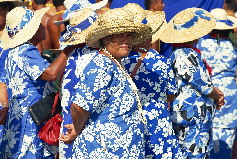 Portrait of a group of women in blue and white dresses, wearing straw hats, in a parade on Independence Day in Apia, on Upolu, Western Samoa, Pacific Islands, Pacific