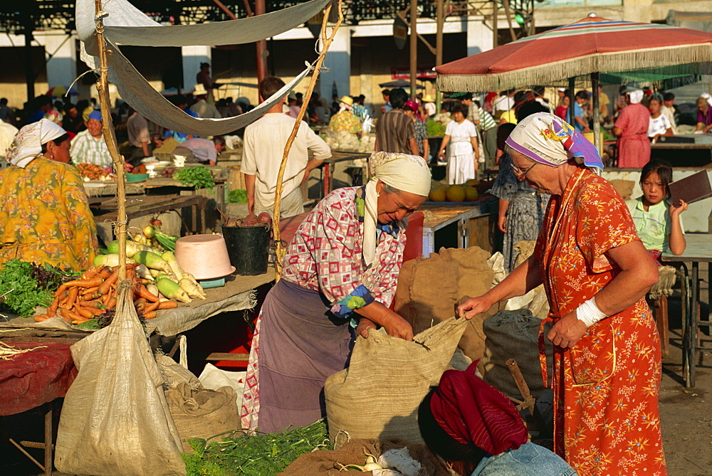 Women selling vegetables in the Osh Bazaar in Bishkek, Kyrgyzstan, Central Asia, Asia