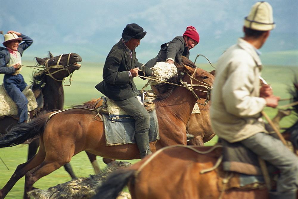 Kirghiz nomads play ulak tartysh, Lake Son-Kul, Kyrgyzstan, Central Asia, Asia