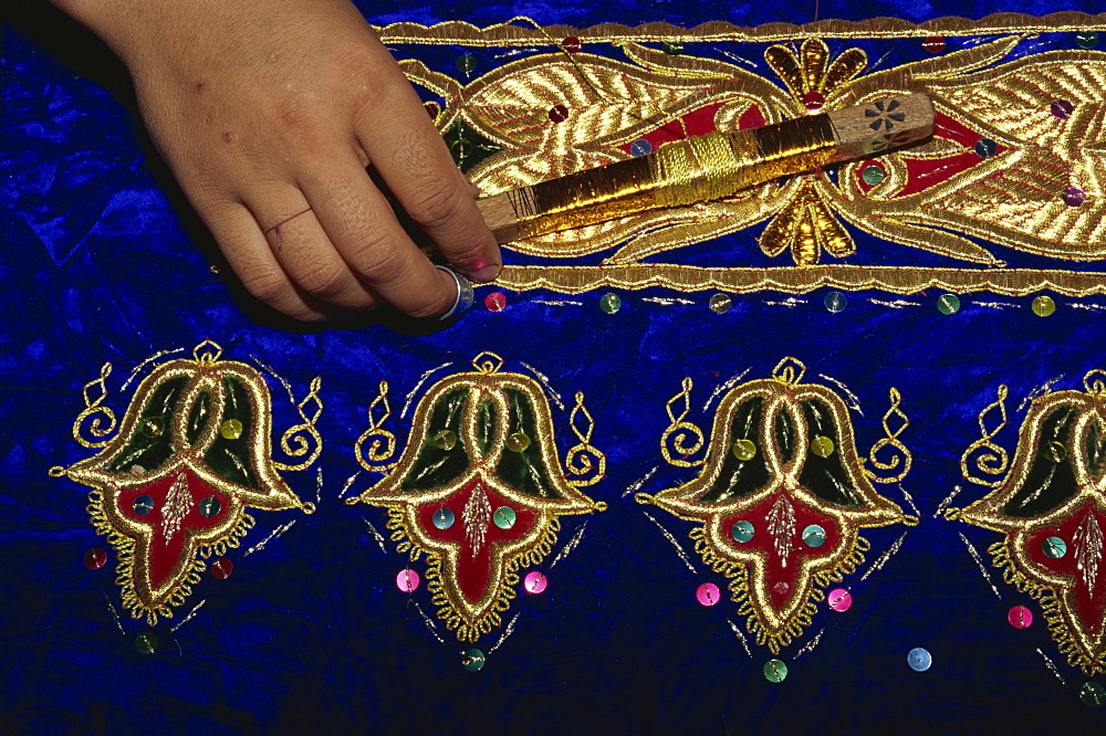 Detail of gold embroidery work in embroidery factory, Bukhara, Uzbekistan, Central Asia, Asia