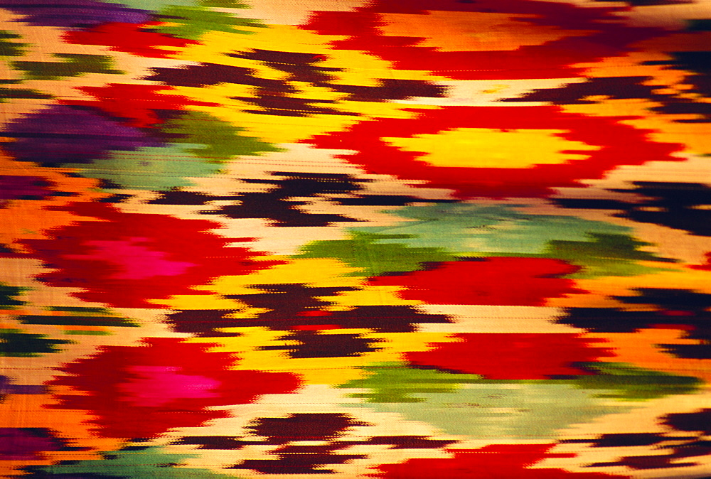 Detail of traditional rainbow silk dress, Bukhara, Uzbekistan, Central Asia