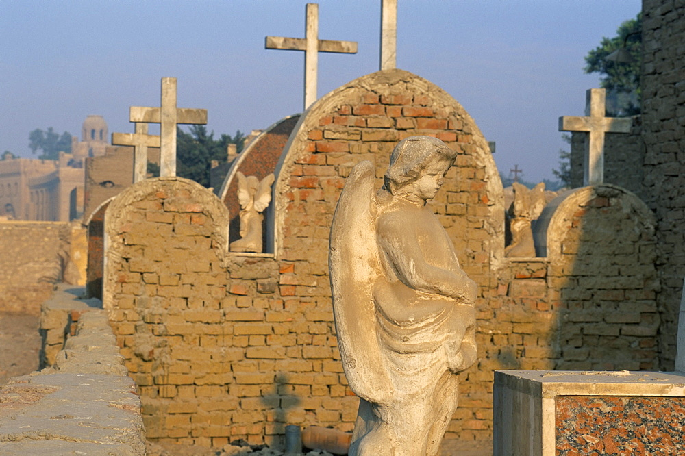 Angel and Christian tombs in Coptic cemetery, Old Cairo, Cairo, Egypt, North Africa, Africa