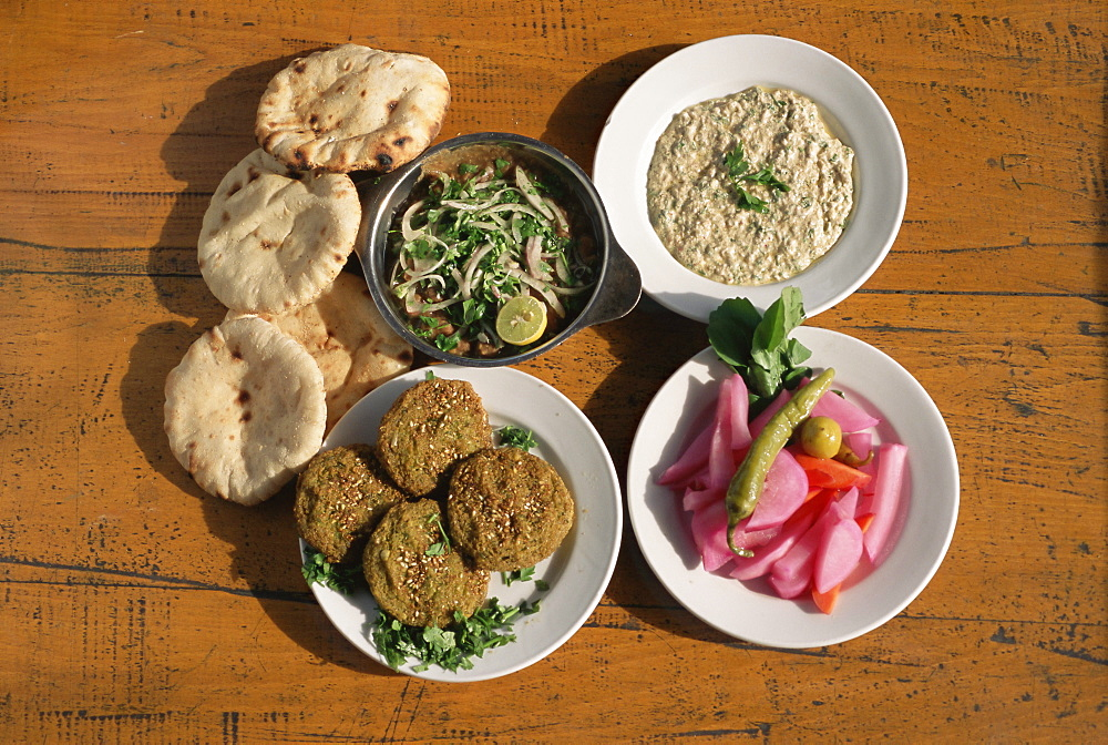 Plates of traditional food, falafel, babaghanoush and shawarma, with flat bread, Cairo, Egypt, North Africa, Africa - 450-3753
