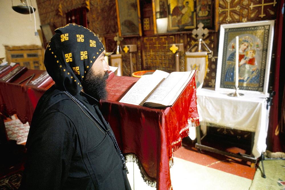 Studying in Apostles church, St. Antony's (St. Anthony's) Coptic monastery, Eastern Desert, Egypt, North Africa, Africa