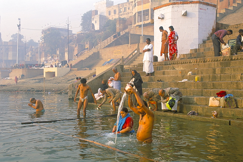 Men and women washing in the River Ganges at Scindia Ghat, Varanasi (Benares), Uttar Pradesh, India, Asia