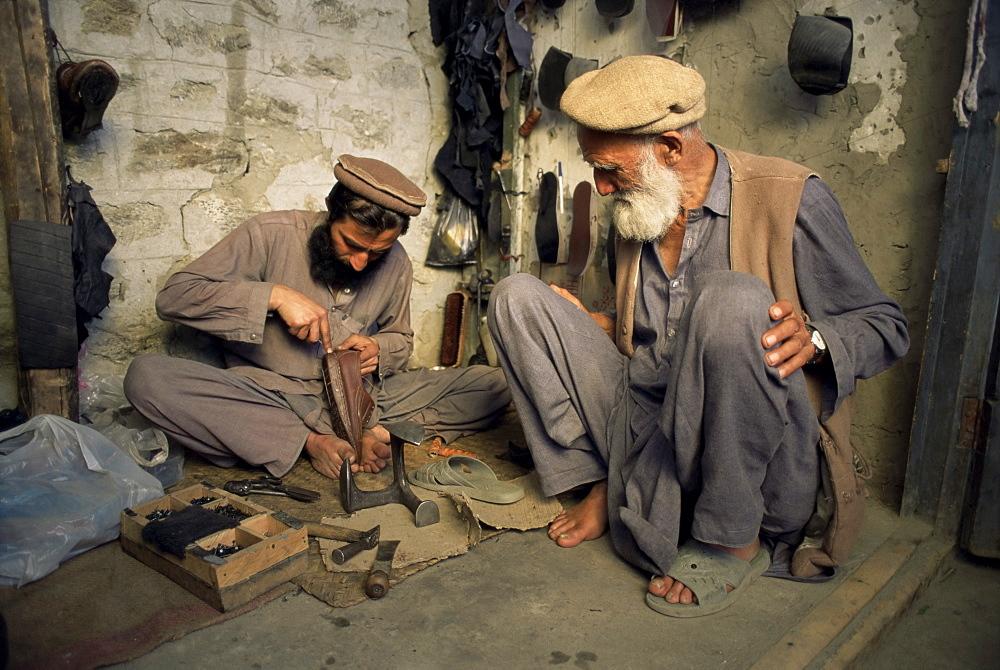 The shoe repair shop, Gilgit, Pakistan, Asia