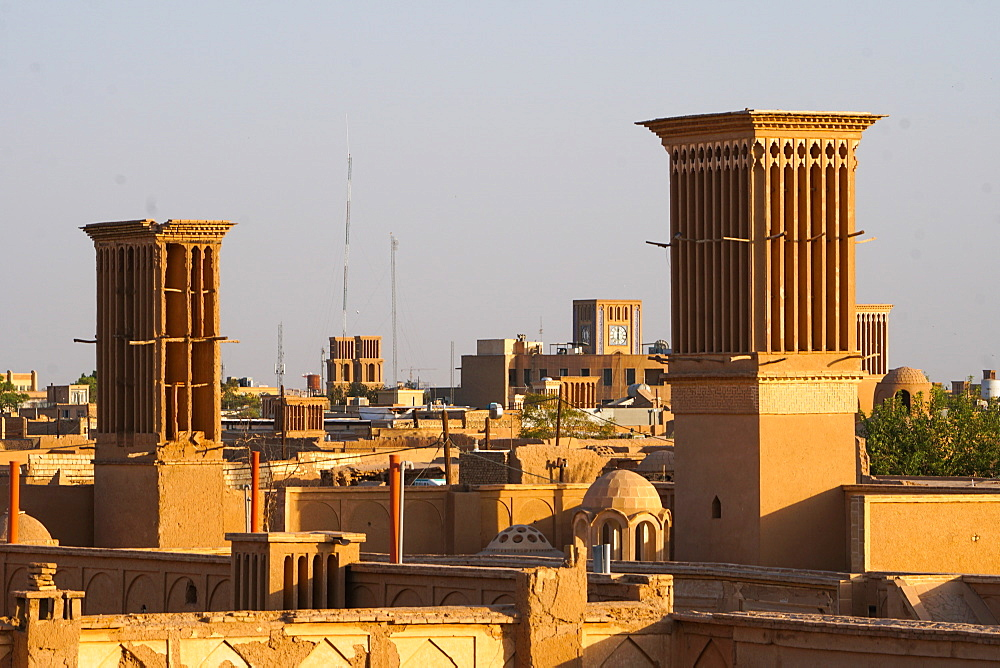 Cityscape at dusk with many windtowers (badgirs), Yazd, Iran, Middle East