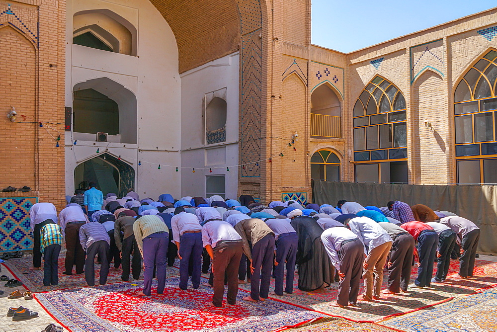 Men praying, Men's Section, Jameh Mosque, Varzaneh, Iran, Middle East