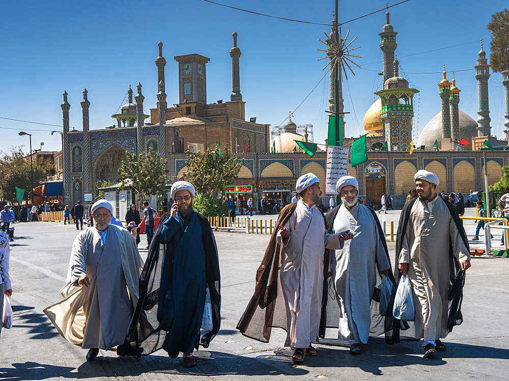 Chatting mullahs against the minarets of the Hazrat-e Masumeh (Holy Shrine), Qom, Iran, Middle East