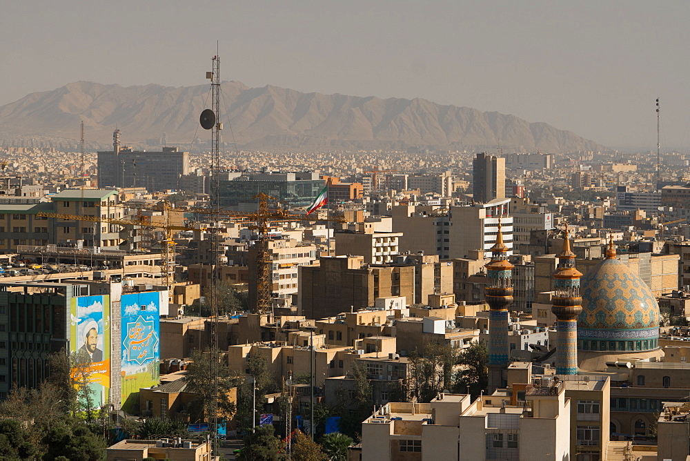 View over buildings from city centre towards Alborz Mountains, Tehran, Iran, Middle East