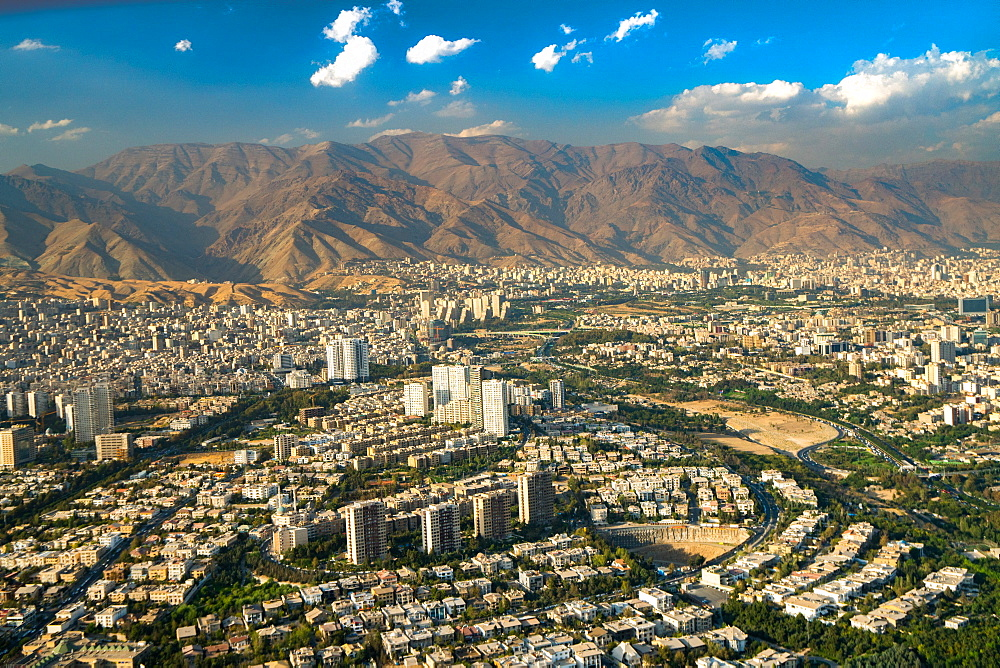 Aerial view of Tehran facing North towards the Alborz Mountains, Tehran, Iran, Middle East