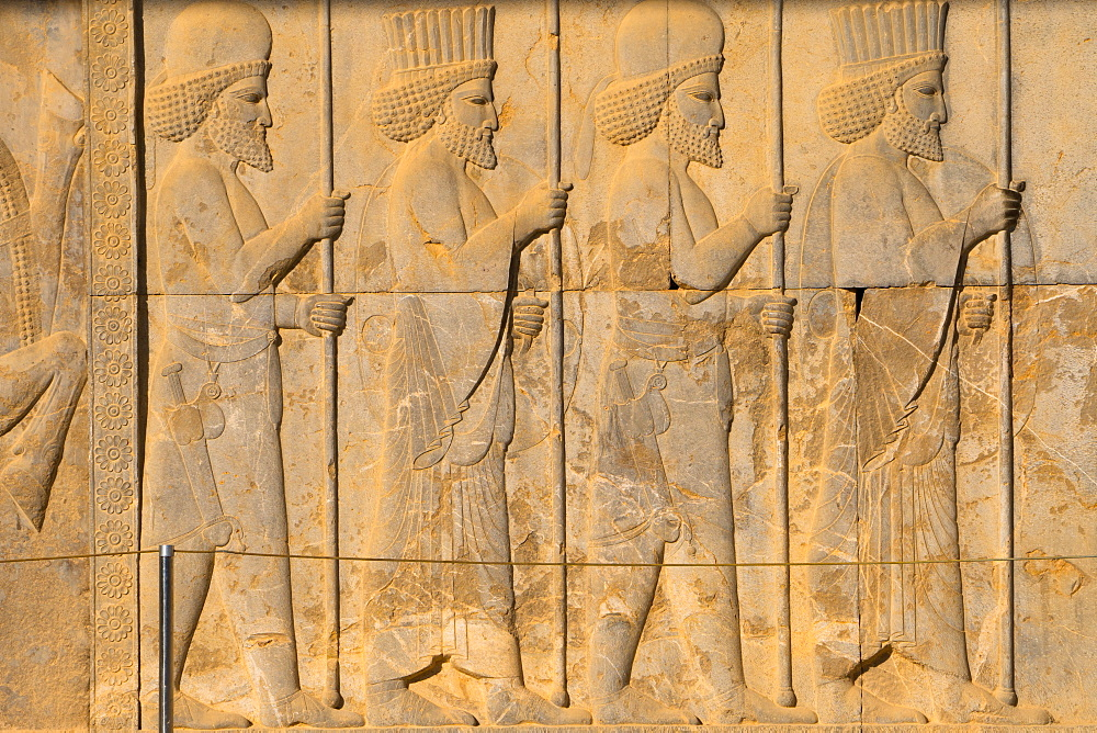 Carved relief of Royal Persian guard, Apadana Palace, Persepolis, UNESCO World Heritage Site, Iran, Middle East