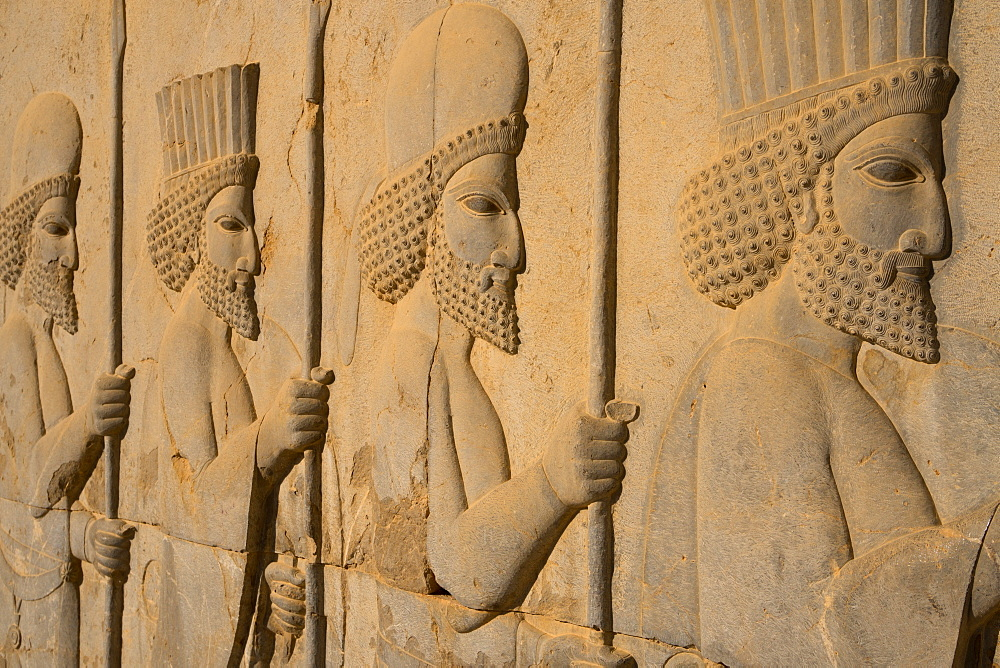 Carved relief of Royal Persian Guards, Apadana Palace, Persepolis, UNESCO World Heritage Site, Iran, Middle East