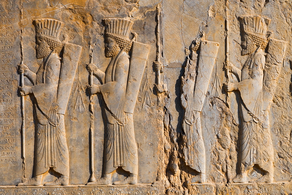Carved relief of four Royal Persian Guards, facade of Private Palace of Darius the Great (Tachara), Persepolis, UNESCO World Heritage Site, Iran, Middle East
