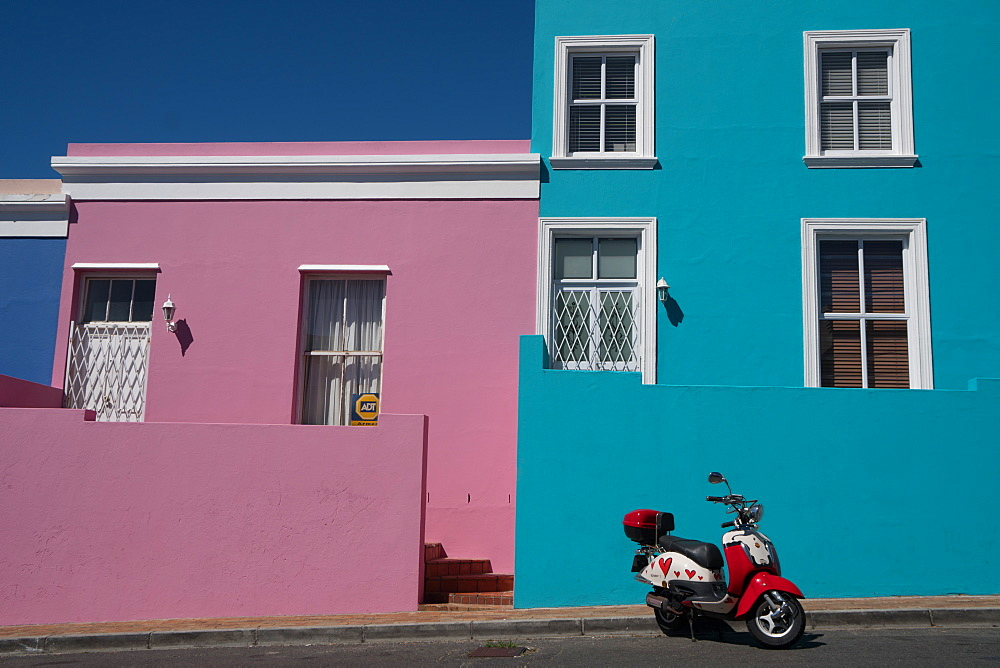 Brightly coloured houses with painted scooter in front, Waal Street in Bo-Kaap, the Malaysian and Muslim area, Cape Town, South Africa, Africa