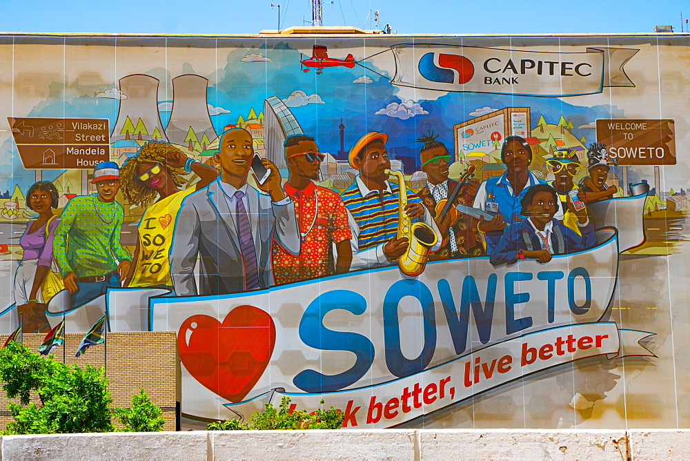 Public painted welcome and advertising sign of bank better, live better, on wall at entrance to Soweto (South Western Township), Johannesburg, South Africa, Africa